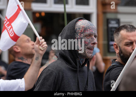 Worcester, United Kingdom. 1 September 2018. The English Defence League (EDL) held a national demonstration in the West Midlands town of Worcester, approximately 200 people attended. A counter-protest was held a short distance away with approximately 500 people. PICTURED: An EDL Supporter with a heavily tattooed face in Worcester town centre. Credit: Peter Manning/Alamy Live News - Stock Image