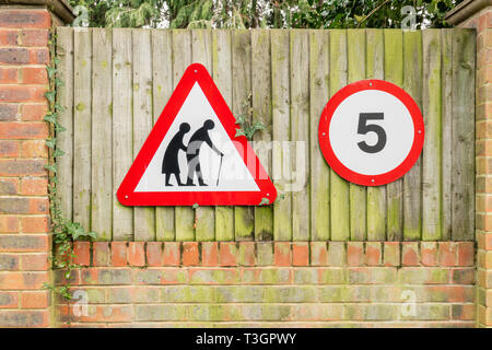 Elderly people and 5mph road traffic signs, England, UK - Stock Image