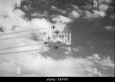 Red Arrows flying display at Malta International Airshow 2014, Fred formation - Stock Image