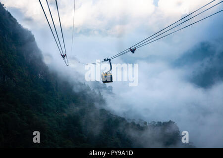 View from Fansipan Cable Car during the rain. Longest non-stop three-rope cable car in the world. Sa Pa, Vietnam. - Stock Image