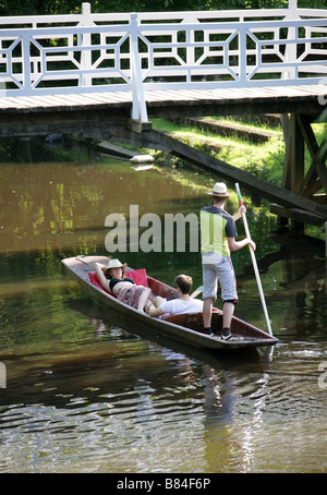 Punting Near Magdalen Bridge on the Cherwell River, Oxford, Oxfordshire, UK - Stock Image