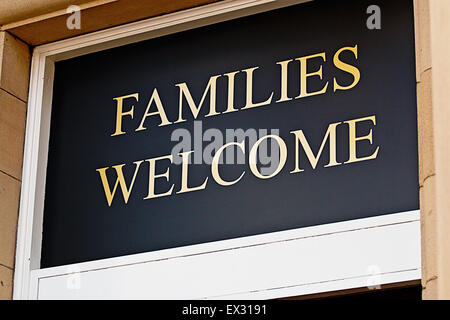 Families welcome sign outside restaurant inviting children to eat bar meals in selected licensed premises - Stock Image