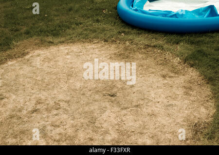 deflated swimming pool - Stock Image