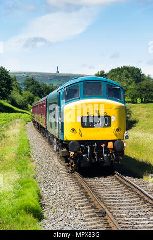 Class 45, British Railway type 4 Sulzer diesel locomotive 45018, approaching Burrs Country Park train station on the East Lancashire Railway. - Stock Image