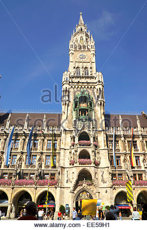 The Rathaus Glockenspiel dominates Marienplatz, the central town square in München / Munich, Germany. - Stock Image