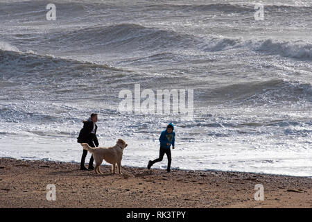 Hastings, East Sussex, UK. 9th February 2019. Strong winds and rough seas driven by Storm Erik, on the Old Town Stade beach. Credit: Carolyn Clarke/Alamy Live News - Stock Image