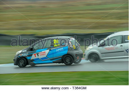 Dunfermline, Scotland, UK. 7th April, 2019.    24 Kyle Grant passes 888 Ross Dunn into the Chicane during a Scottish Citroen C1 Cup race at Knockhill Circuit. During a wet and misty opening round of the Scottish Championship Car Racing season organised by the SMRC (Scottish Motor Racing Club) at Knockhill. Credit: Roger Gaisford/Alamy Live News - Stock Image