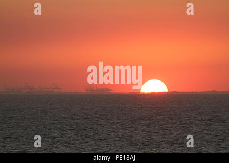 UK: 4 August July 2018: Sunset over the North Sea from a sea vessel sailing from the river Thames estuary on 4 August. Temperatures in the UK remain in the high 30's degrees for a third week running Credit: David Mbiyu/ Alamy Live News - Stock Image