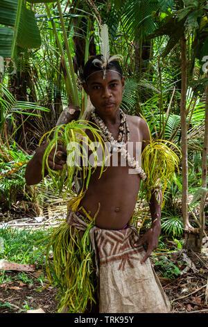 young Kofure Man in traditional Tapa Dress, Tufi, Oro Province, Papua New Guinea - Stock Image