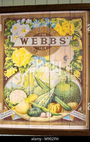 An old 19th century cover of an annual seed catalogue forms part of the pictorial decor in a Midlands garden centre. - Stock Image