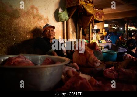 Butcher at the Ubud Markets, Bali Indonesia - Stock Image
