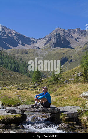 Short Rest At A Mountain Stream In The Ötztaler Alps - Stock Image