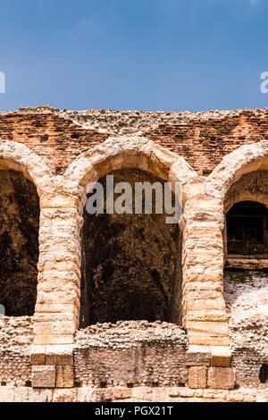 Roman amphitheatre arches at Piazza Bra in Verona, Italy - Stock Image