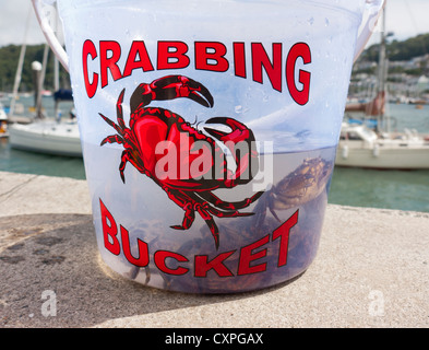 A crabbing bucket on a harbor wall in Britain - Stock Image