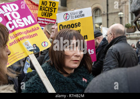 London, UK. 9th Dec, 2018. A woman in the crowd at the start of the united counter demonstration by anti-fascists in opposition to Tommy Robinson's fascist pro-Brexit march. The march which included both remain and leave supporting anti-fascists gathered at the BBC to to to a rally at Downing St. Police had issued conditions on both events designed to keep the two groups well apart. Credit: Peter Marshall/Alamy Live News - Stock Image