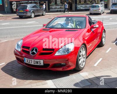 A 2000 registered red Mercedes Benz SLK sports roadster motor car - Stock Image