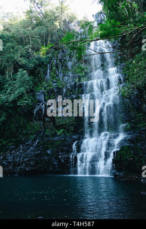 Salto Cristal cascading waterfalls secluded in a rainforest, surrounded by exuberant vegetation, Paraguari Department, Paraguay - Stock Image