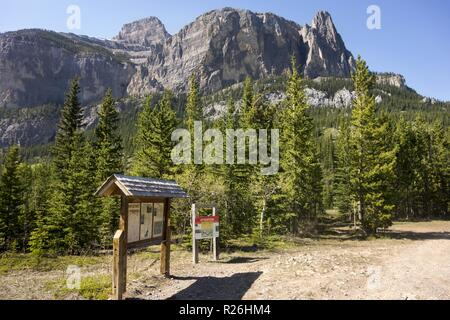 Trailhead Park Sign at Rarely Visited East Boundary of Banff National Park in Ghost Area of Alberta Foothills near Devil's Gap - Stock Image