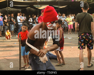 Navotas City, Philippines. 4th Jan, 2012. A masked flagellate seen whipping his back during Good Friday. Credit: Josefiel Rivera/SOPA Images/ZUMA Wire/Alamy Live News - Stock Image