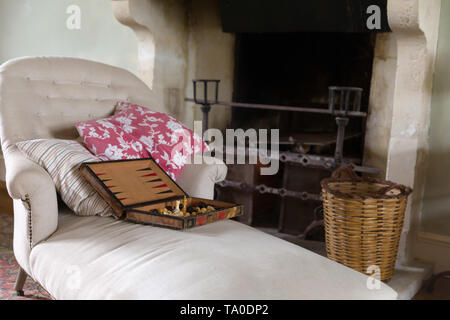 Still life interior with old fireplace and antique backgammon game - Stock Image