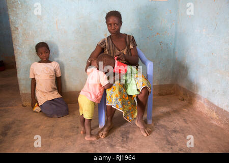 Samba village, Yako Province, Burkina Faso; Sally Zoundi, 35, with her baby Salomon Zoundi, 15 months, and her daughter Zalissa Zoundi, 10. - Stock Image