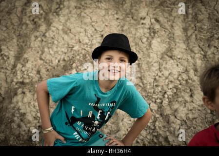 Portrait of boy in hat - Stock Image