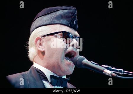 Elton John performing in concert in Paris during his Reg Strikes Back Tour. 23rd March 1989. - Stock Image