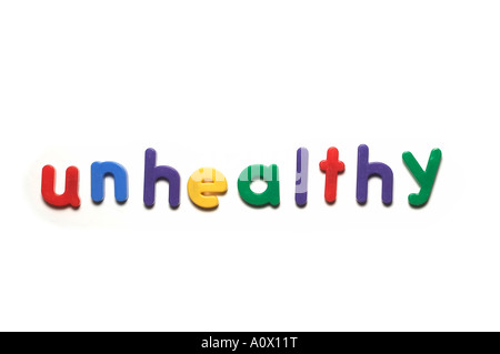 alphabet fridge magnets spelling unhealthy,words - Stock Image