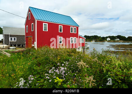 Picturesque red house on stilts, Cape Porpoise, Maine USA. - Stock Image