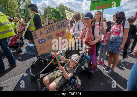 London, UK. 12th May 2019.People on the XR International Mothers Day March by several thousand mothers, children and some fathers from Hyde Park Corner to a rally filling Parliament Square, backing Extinction Rebellion's call for the drastic and urgent action needed to avert the worst consequences of climate change, including possible human extinction. Our politicians have declared a climate emergency but now need to take real action rather than continuing business as usual which is destroying life on our planet. Peter Marshall/Alamy Live News - Stock Image