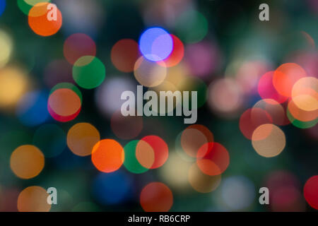 Out of focus fairy lights on a Christmas tree in England - Stock Image