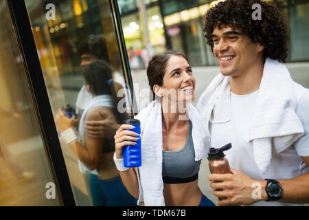 Couple jogging and running outdoors in city - Stock Image