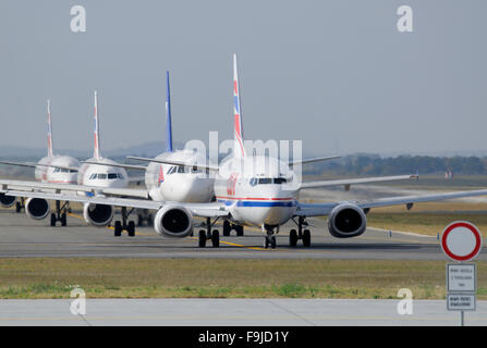 Long Queue of Planes on a Taxiway  - a Rush Hour at Prague Airport - Stock Image