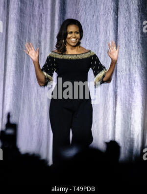 O2 Arena, London, UK. 14th Apr 2019. Michelle Obama on stage at Becoming: An Intimate Conversation With Michelle Obama on Sunday 14 April 2019 at O2 Arena, London. . Picture by Julie Edwards. Credit: Julie Edwards/Alamy Live News - Stock Image