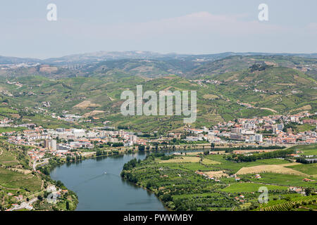 patterns of vineyards along the river Douro in the Alto Douro Port Wine region of Portugal in Summer looking towards the area of Peso da Regua - Stock Image