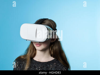 Girl 12- 14yo wearing virtual reality head set goggles, VR Glasses - Stock Image