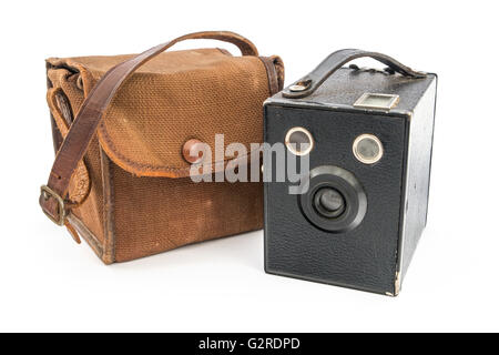 Vintage Box Brownie Camera and a brown canvas case over white. - Stock Image