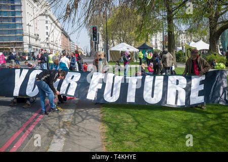 Attending to the banner blocking the road at the Extinction Rebellion demonstration at Marble Arch - Stock Image