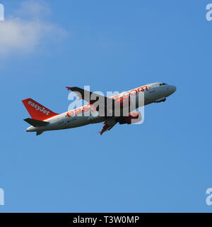 Easy Jet passenger jet aircraft taking off from Luton Airport, Bedfordshire, England, UK - Stock Image
