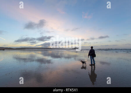 Longrock, Cornwall, UK. 2nd March 2019. UK Weather. There was a clear sky and little wind at sunrise this morning on the beach at Longrock, looking towards St Michaels Mount. However the area is on a Met office Weather warning from Sunday, as storm Freya is due to bring heavy rain and galeforce winds. - Stock Image