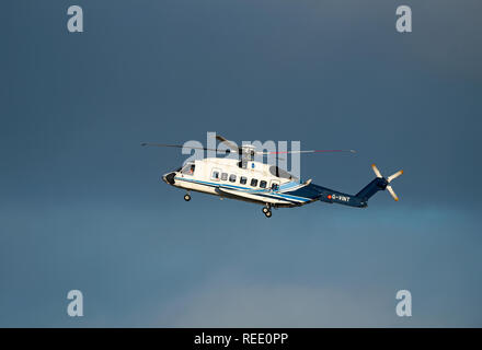 A Sikorsky S92-A helicopter from the Babcock MCS Offshore/Onshore fleet returning to Aberdeen Heliport at Dyce airport in UK. - Stock Image