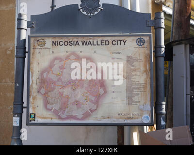 Information board with map of the historic walled city of Nicosia Cyprus placed in the northern (Turkish) half of the city - Stock Image