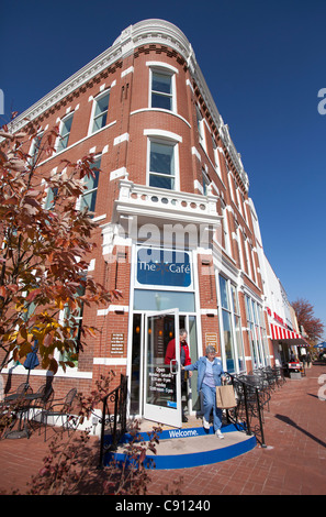 Visitors exit The Spark Cafe at the Walmart Visitor's Center in downtown Bentonville, Ark. - Stock Image