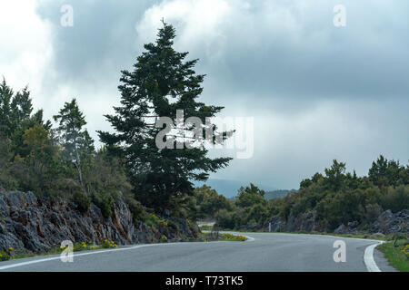 Driving car on roads of Peloponnese, roads network in Greece, vacation and tourist destination - Stock Image