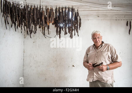 Man Making biltong in Ghanzi, Botswana - Stock Image