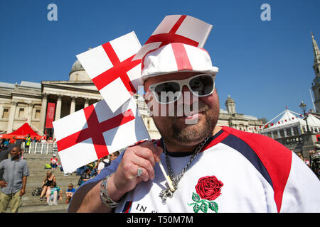 Trafalgar Square. London, UK. 20th Apr, 2019. Revellers attend the annual 'Feast of St George' event in Trafalgar Square, to celebrate the Patron Saint of England. St George's Day is on 23 April. Credit: Dinendra Haria/Alamy Live News - Stock Image