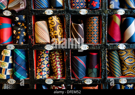 A selection of colourful vintage silk ties displayed in a hotel key box. - Stock Image