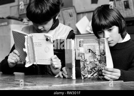 Education: Lack of text books in the early 1980's led to school children having to share books. Books were repaired many times and were only replaced when they could not be read. March 1981 PM 81-01143-001 - Stock Image