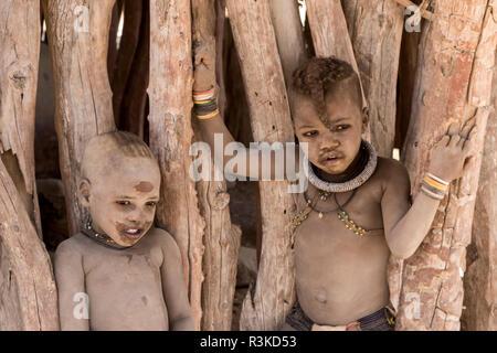 Africa, Namibia, Opuwo. Two dusty Himba children. Credit as: Wendy Kaveney / Jaynes Gallery / DanitaDelimont.com - Stock Image