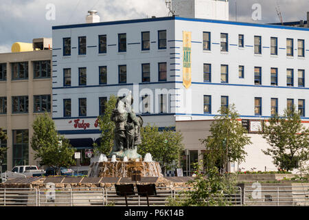 Golden Heart Plaza and the statue by artist Malcolm Alexander called the Unknown First Family, downtown  in Fairbanks, Alaska. The downtown plaza was built to celebrate the silver anniversary of Alaska statehood in 1984. - Stock Image